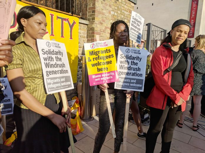 The demonstration in Brixton on Friday night condemned PM May's 'deliberately unreachable bar' for migrants as racism