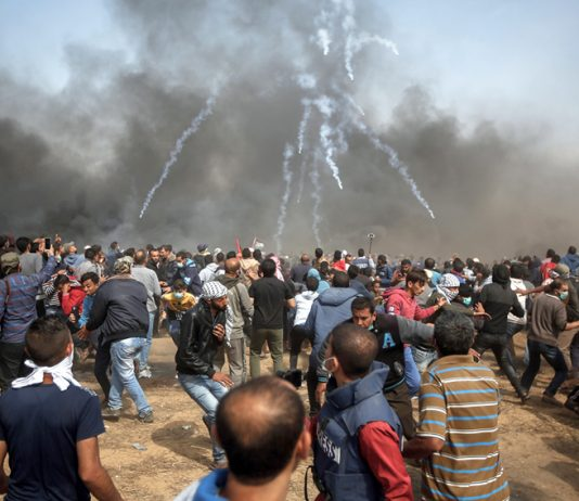 Palestinians on the Great March of Return on the Gaza border on Friday defy Israeli army snipers and hails of teargas