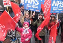 Children join the NHS march through London earlier this year – West Midlands Ambulance Service is pulling out of its contract