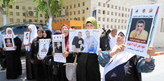 Palestinian prisoners' families demonstrate in solidarity with the hunger strikers in the prisons of the occupation