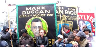 Banners of Mark Duggan, shot dead by police in August 2011 in Tottenham, sparking the summer uprising of youth