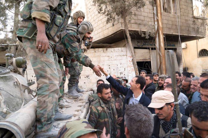 Syrian troops greet President Assad in Ghouta after successfully liberating the district from terrorist occupation