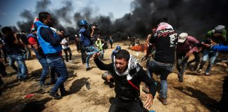 Palestinians close to the Gaza-Israel border fence. Over 100 have been killed since Land Day March 30