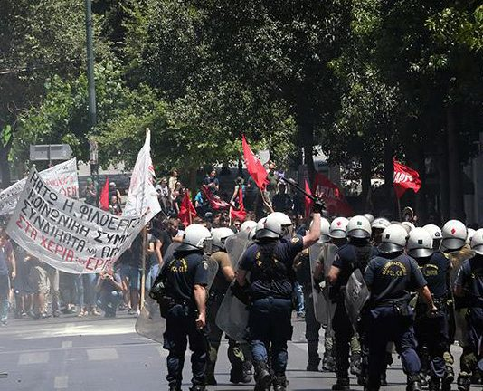 Riot police attack demonstrators on Wednesday in Athens. Photo credit: Marios Lolos