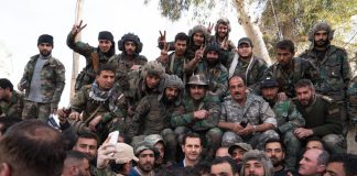 Syrian President ASSAD (centre) with Syrian troops after they liberated the region from Islamist terrorists