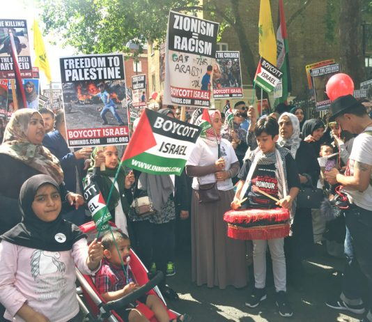 An enthusiastic crowd gathers at the start of yesterday's Al Quds march outside the Saudi Embassy in central London