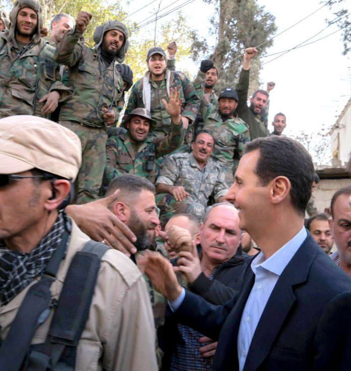 Syrian troops greet President Assad after the victory over the terrorists in Eastern Ghouta