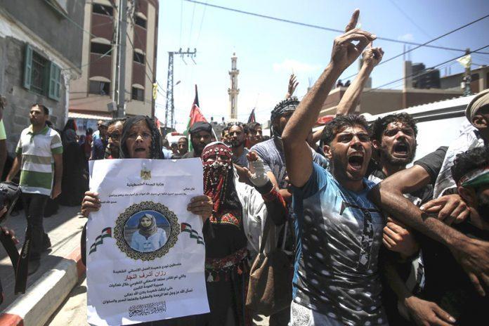 Palestinians on the funeral march of Palestinian paramedic Razan Ashraf al-Najjar killed by Israeli forces on the Gaza-Israel border