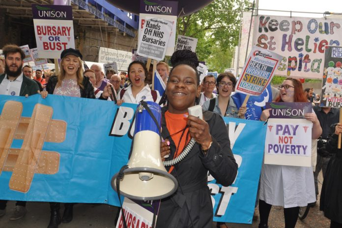 Nurses on a demonstration fighting against the cutting of nurses bursaries – there is now a shortfall of 35,000 nurses