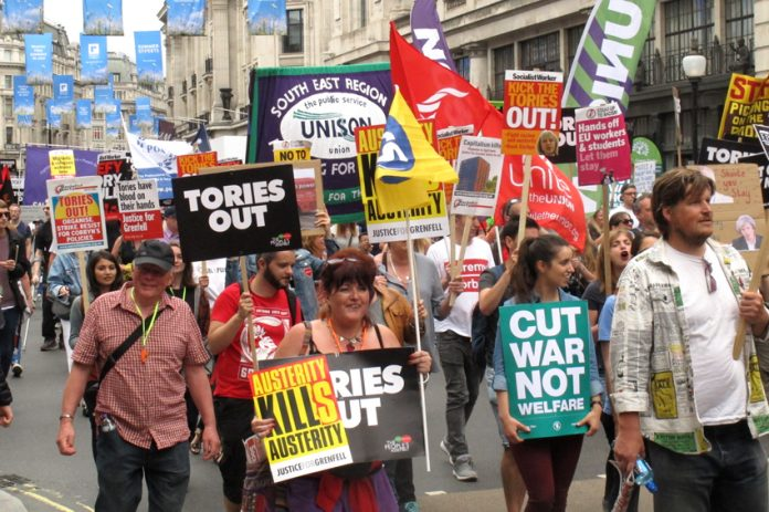 Workers and young people march on a Tories Out! demonstration last year