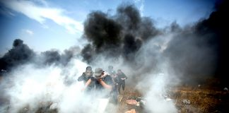 Palestinians demonstrating on the Gaza border with Israel under attack from Israeli armed forces