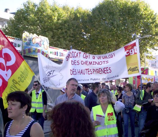 Striking French railway workers on a demonstration against the Macron government's attempted privatisation of SNCF