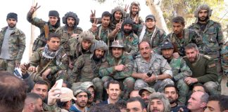 Syrian President BASHAR AL-ASSAD surrounded by Syrian troops during the liberation of Ghouta