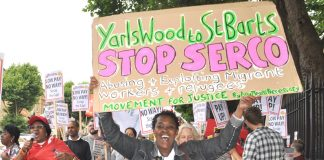 Protester demands the Seco-run Yarl's Wood detention centre is shut down – Serco are now evicting hundreds of asylum seekers