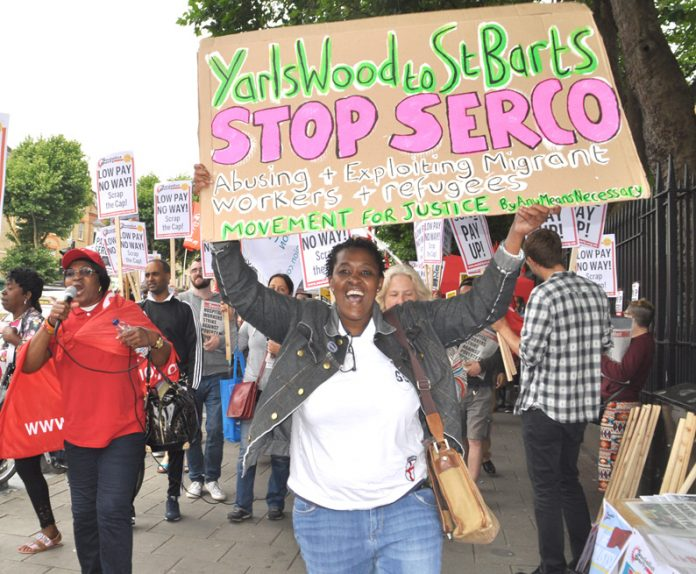 Protester demands the Serco-run Yarl's Wood detention centre is shut down – Serco are now evicting hundreds of asylum seekers