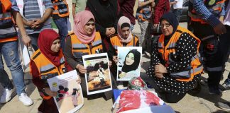 Palestinians in Bethlehem commemorate Razan al-Najjar, the 21-year-old Palestinian volunteer  paramedic, shot dead in Gaza by an Israeli sniper on the border with Israel on June 1st