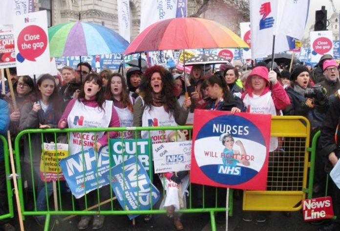Nurses demonstrate outside Downing Street in defence of the NHS