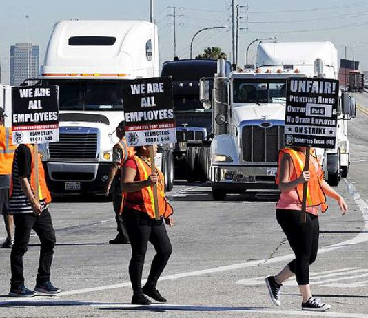 Teamster union port workers demonstrating against 'misclassification' – the New Jersey Attorney General has lodged a complaint against 'misclassification'