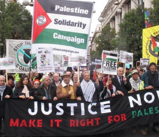 Palestinian Ambassador MANUEL HASSASSIAN (centre, in cap) on a march in London last November to condemn the Balfour Declaration
