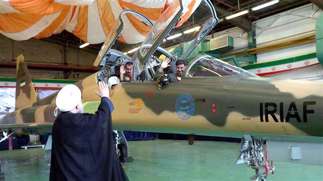 Iranian President HASSAN ROUHANI waves to pilots at the launch of the Kowsar fighter jet