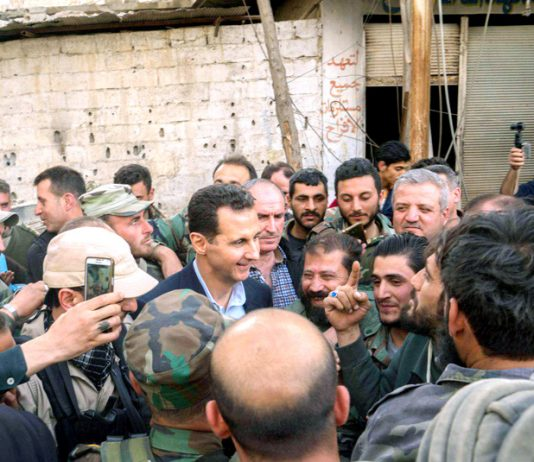 Syrian President BASHAR AL-ASSAD greets troops after the liberation of Ghouta province