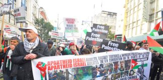 Banner on the 'Justice Now' demonstration in London earlier this year demanding a boycott of Israel