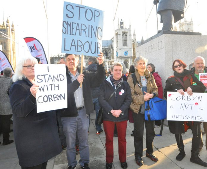 Labour Party supporters of Jeremy Corbyn protesting at the right-wing witch-hunt against him