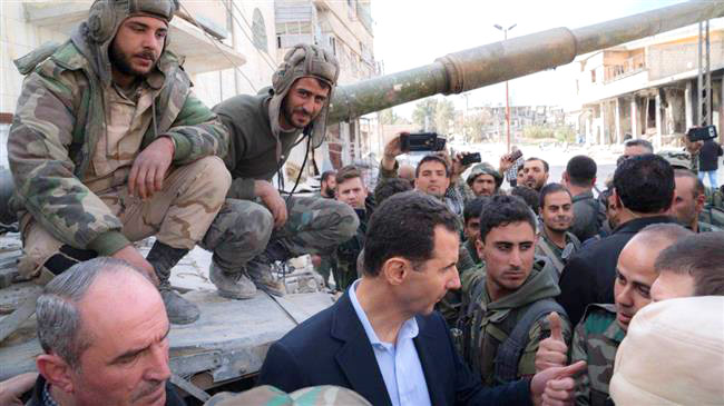 Syrian president BASHAR AL-ASSAD greeted by Syrian troops after the victory in Eastern Ghouta