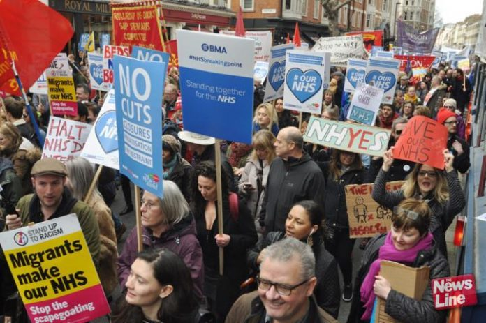 BMA members marching against Tory cuts and privatisation