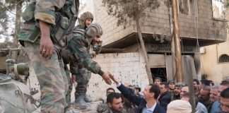 Syrian President BASHAR AL-ASSAD greeted by his troops in Ghouta after they liberated the region from terrorists – they are now preparing to take Idlib