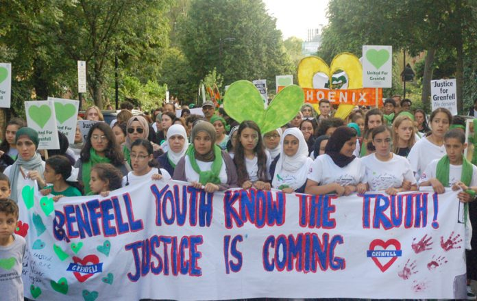 Youth marching on the mass march on the anniversary of the Grenfell fire – TUC delegates demand flammable cladding is banned
