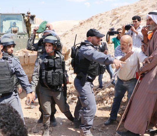 Israeli military bulldozer razing Palestinian farmland