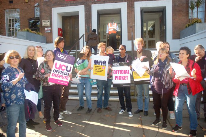Striking Lewisham Southwark College lecturers are determined to win a pay rise after years of no increments