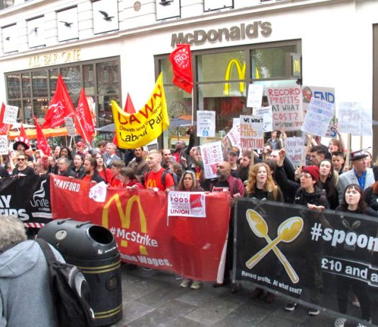 Fast food workers rallying outside McDonald's in Leicester Square, central London yesterday demanded 'Fair Pay Now!'