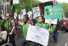 Local residents join forces with firefighters to demand 'No Justice No Peace' on a march last June – the North Kensington Law Centre claims that Grenfell survivors are being pressurised into accepting sub-standard housing, 150 families are still without h