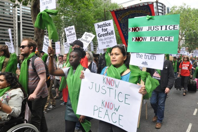 Local residents join forces with firefighters to demand 'No Justice No Peace' on a march last June – the North Kensington Law Centre claims that Grenfell survivors are being pressurised into accepting sub-standard housing, 150 families are still without homes