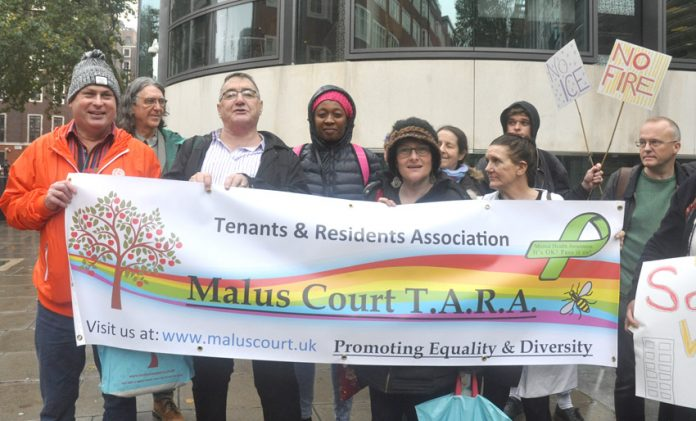 GRAHAM LANGTON (left) with tenants from Salford's Malus Court