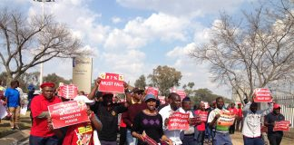 Demonstrators on the march against Eskom, which is being milked by privateers