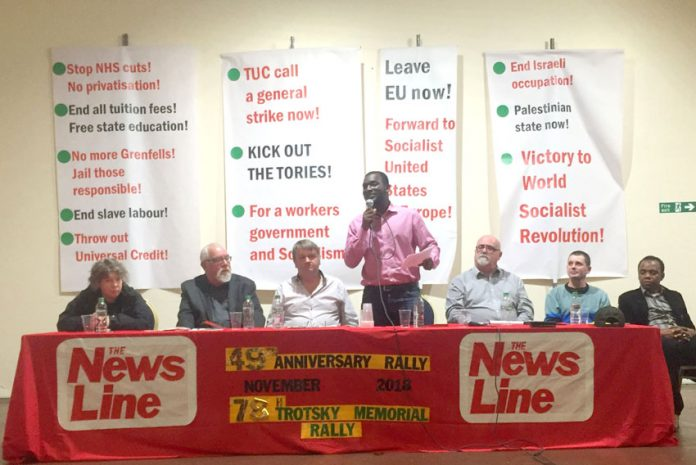Platform at the News Line Anniversary Rally (L-R) KAREN MENPES (GMB cab drivers), DAVE WILTSHIRE (WRP CC) FRANK SWEENEY (Chair) JOSHUA OGUNLEYE (WRP Gen Sec) GARY PALMER (GMB Southern Region) JONTY LEFF (News Line Editor) MOHAMED BARRY (Ridley Road Market