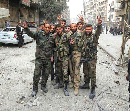Syrian troops celebrate a victory against terrorist forces
