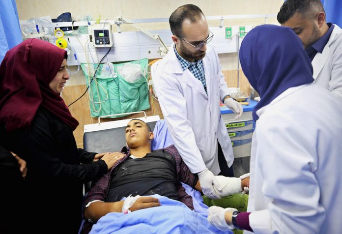 A High School student form Urif village being treated in the Rafidiya Hospital in Nablus, after being injured during an attack by settlers