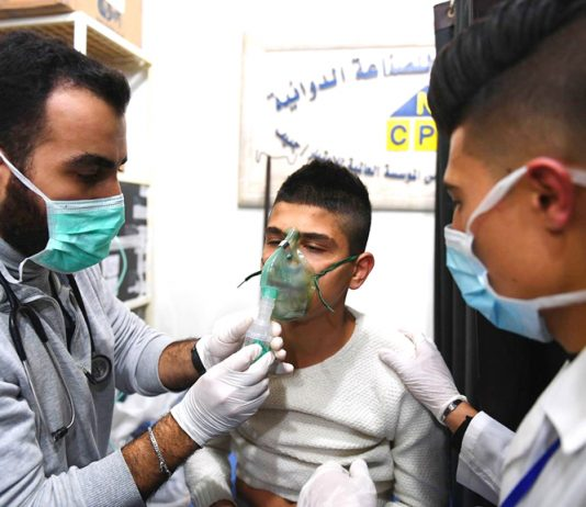 A young victim of the terrorist gas attack in Aleppo is treated in hospital