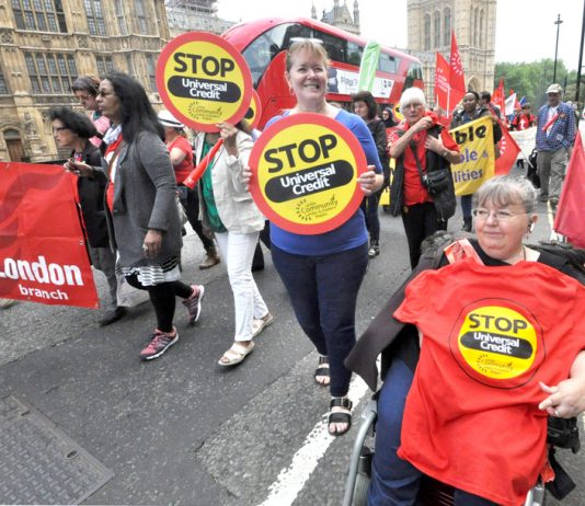 Marchers outside Parliament demanding the scrapping of Universal Credit