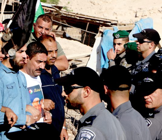 Residents of the Bedouin village of Khan al-Ahmar, east of Jerusalem, confront Israeli police – Israeli forces have ordered the closure of all roads leading to the village