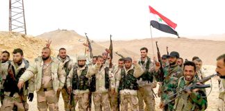 Syrian troops celebrate a victory over terrorists in the north of Syria