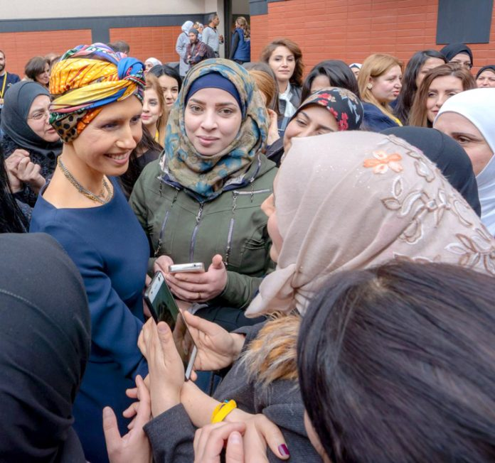ASMA AL-ASSAD, wife of Syrian President Bashar al-Assad, is warmly greeted by lecturers and graduated Master students of Language and Speech at the event  of cooperation between AAMAL and Damascus University