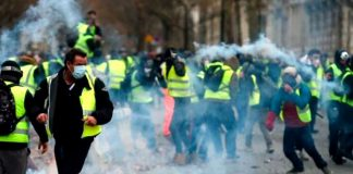 French Yellow Vest demonstrators  in Paris where the French riot police used tear gas rubber bullets and water cannon against them