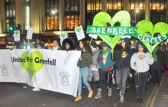 Many young people were on Friday night's 600-strong silent march through the centre of Kensington, London, England demanding justice for the victims of the Grenfell inferno