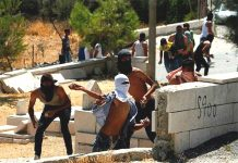 Palestinian youth confront Israeli troops in the West Bank