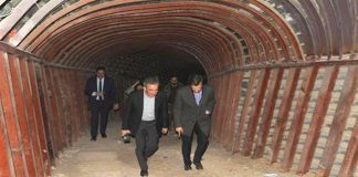 A French delegation led by Thierry Mariani inspects a tunnel dug by terrorists in the city of Duma